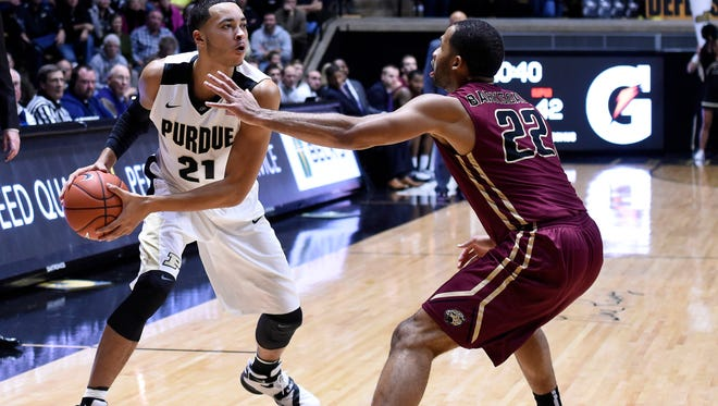 Purdue guard Kendall Stephens (21) looks to pass as IUPUI guard Marcellus Barksdale (22) defends in the 2nd half at Mackey Arena.
