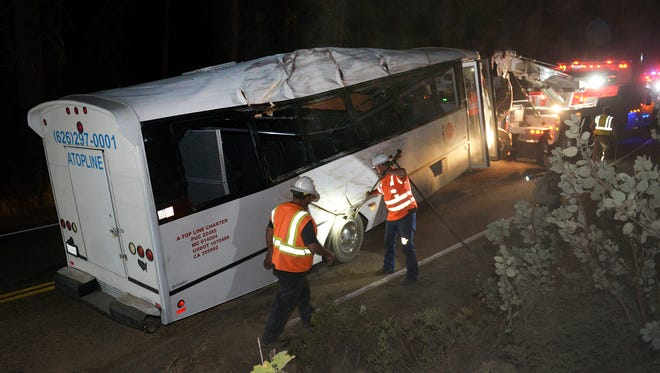 In this Sept, 24, 2016 photo, rescuers work the scene of an accident after a tour bus carrying students from China hit a tree near Yosemite National Park outside the Sierra Nevada town of Oakhurst, Calif. The California Highway Patrol said Sunday at least one passenger was killed and 11 were injured in the accident, the Fresno Bee reports. (Craig Kohlruss/The Fresno Bee via AP)