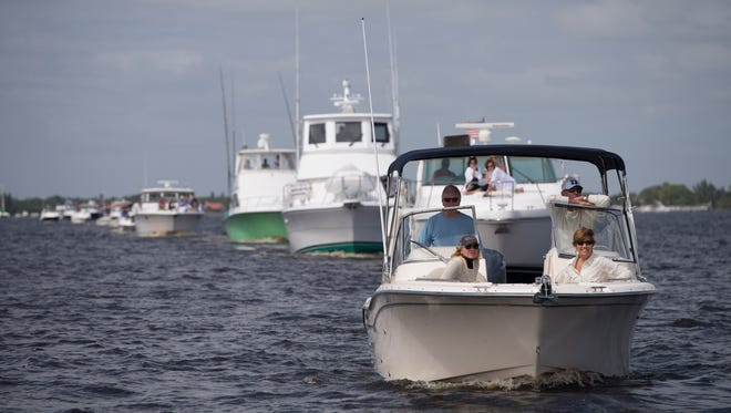A line of boats proceed during the 45th annual Blessing of the Fleet on the St. Lucie River in Stuart in 2016. The annual event will take place at noon Saturday and is open to all boaters.