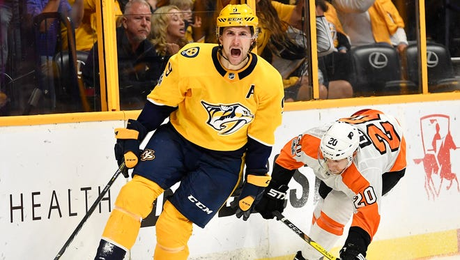 Nashville Predators left wing Filip Forsberg (9) celebrates his goal during the third period of the home opener at Bridgestone Arena in Nashville, Tenn., Tuesday, Oct. 10, 2017.