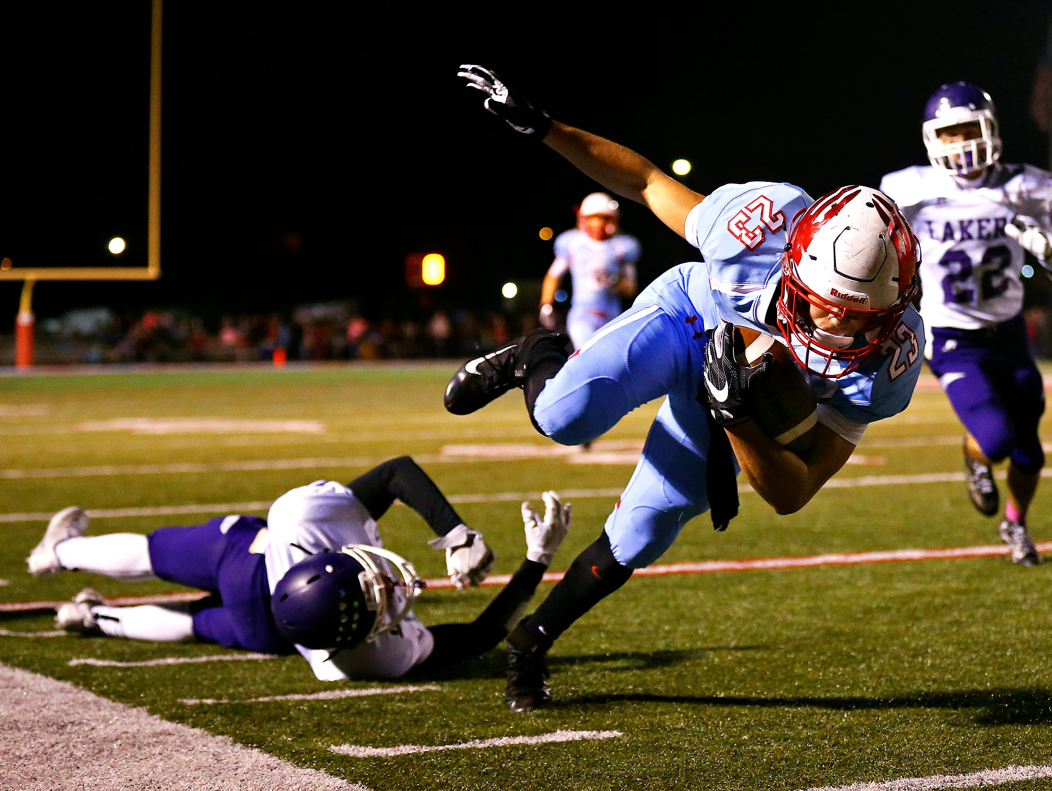 Glendale High School wide receiver Nader Leali (23) tries to maintain his balance after a hit by Lakers defensive back Matt Lawson during second quarter action of the game between Glendale High School and Camdenton High School at Lowe Stadium in Springfield, Mo. on Oct. 14, 2016.