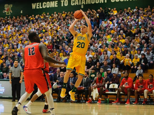 Vermont's Ernie Duncan (20) takes a shot during the