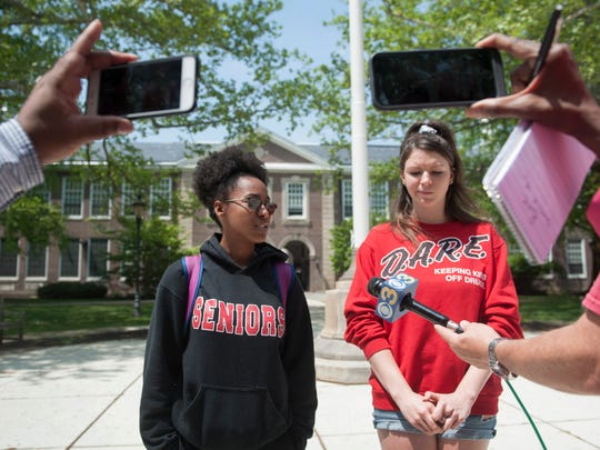 Haddonfield High School students Adianna Alston, left, and Taylor Bee speak to members of the media stationed outside of the school to cover an anticipated student walkout expected on Monday after the school district announced Friday it had canceled the rest of the 2018 boys' lacrosse season following an investigation into allegations that a Haddons' lacrosse player called a Sterling High School girls' track athlete the N-word at a track meet here May 1.  The anticipated walkout did not occur Monday.
