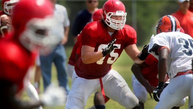 Oakland's Jack Jones defends the line during a scrimmage against Beech at Oakland, on Friday August 1, 2014.