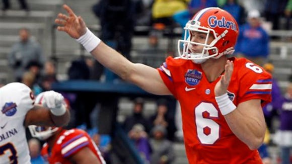 Florida quarterback Jeff Driskel (6) throws a pass during the first half of the Birmingham Bowl NCAA college football game against East Carolina, Saturday, Jan. 3, 2015, in Birmingham, Ala. (AP Photo/Butch Dill)