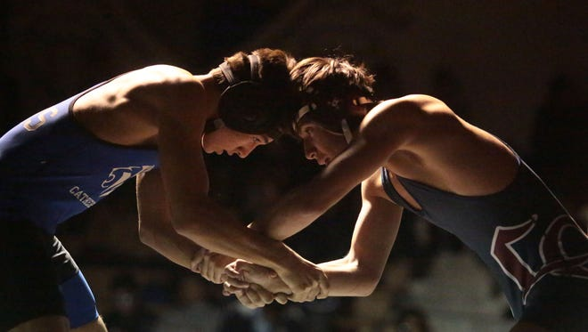 Cathedral City's Deming Franz is matched with La Quinta's Luis Espinoza in the 120-pounds class on Wednesday in Cathedral City.