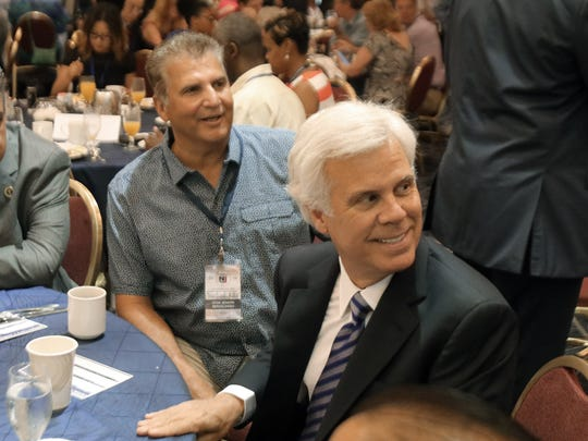 Camden County's George Norcross and Essex County's Joseph DiVincenzo sit together during the NJ Delegates breakfast Monday.