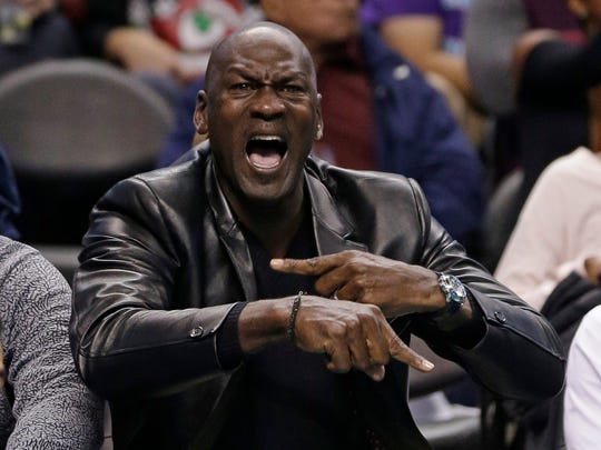Charlotte Hornets owner Michael Jordan yells at an official in the first half of an NBA basketball game against the Chicago Bulls in Charlotte, North Carolina on December 23. Jordan plans to build a golf course in Martin County.