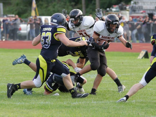 Marine City running back Aren Sopfe gets taken down during a play against Algonac Aug. 24.