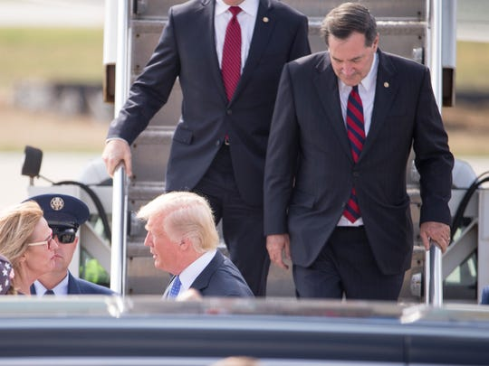 Senator Joe Donnelly (right), exits Air Force One,