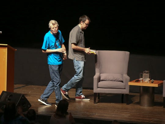 Stephen King and Owen King are welcomed to the stage