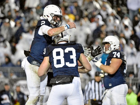 Penn State quarterback Tommy Stevens (2) celebrates with Nick Bowers (83) after Hoenstine's touchdown in the second half of an NCAA Division I football game Saturday, Nov. 18, 2017, at Beaver Stadium. Penn State defeated Nebraska 56-44 in its final home game of the 2017 season.