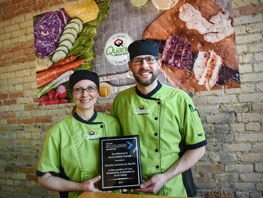 Adam and Lisa Schulte hold the Excellence in Food Safety