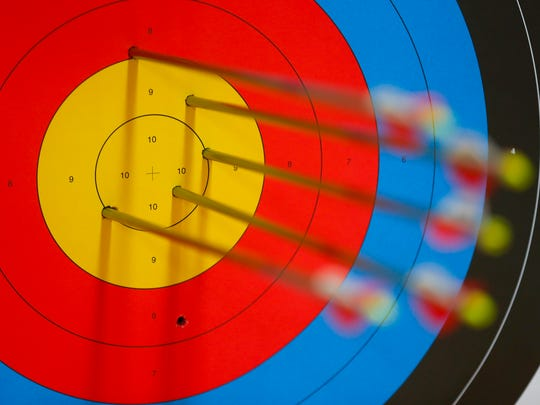 Arrows in a target during a practice for an archery competition at the O'Reilly-Tefft Gymnasium on Tuesday, Jan. 9, 2018.