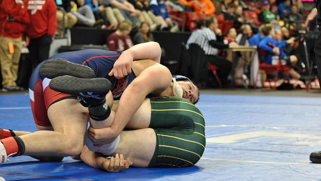 Tory Jandrin of Southern Door takes down Alex Lemanski of Edgar in overtime in their WIAA Division 3 state wrestling championship quarterfinal match at 195 pounds. The points from this takedown gave Jandrin the win.