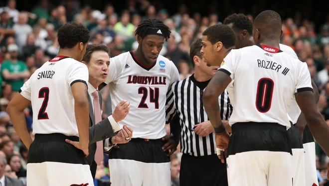 U of L head coach Rick Pitino tries to rally his team against Michigan State during the Elite 8 tournament game in Syracuse, NY.  March 29, 2015