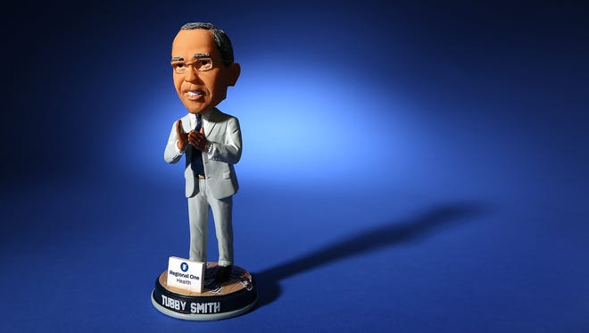 he University of Memphis Tigers will give out Tubby Smith bobble heads at Monday's home opener.