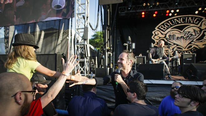 Bouncing Souls frontman Greg Attonito, on stage during the Common Ground Music Festival in downtown Lansing in July.