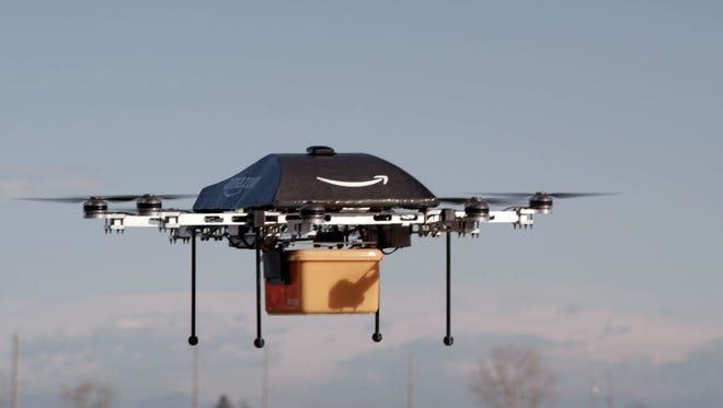 "This photo released by Amazon on Dec. 1, 2013, shows a flying ""octocopter"" mini-drone that would be used to fly small packages to consumers."