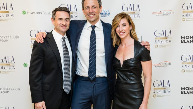 Seth Meyers (center) is pictured with Adam Barrison, MD, Summit Medical Group (left) and Sondra Barrison, SMGF Gala Chair, (on right).