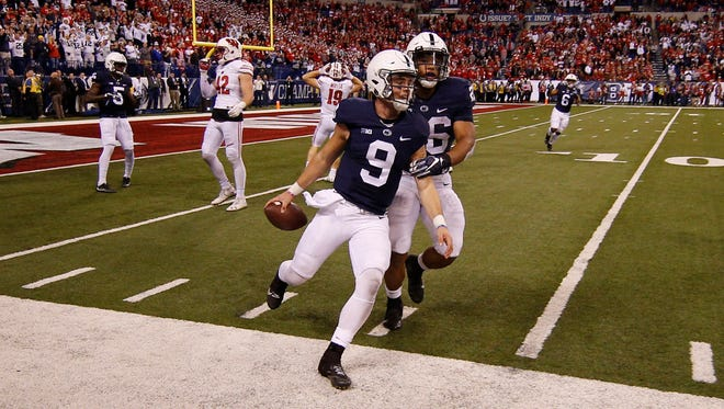 Penn State Nittany Lions quarterback Trace McSorley (9) celebrates the victory with running back Saquon Barkley.