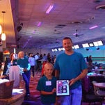 Bowling for Backpacks event helps strike out childhood hunger