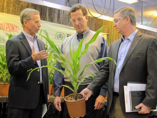 Rick Santorum, center, wears a sweater vest in December