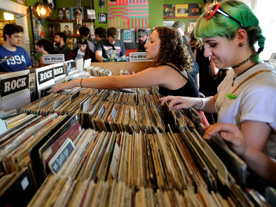 Sophia Bruce, right, goes through records at Groove