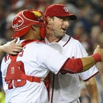 Nationals starting pitcher Max Scherzer (31) celebrates with catcher Wilson Ramos after the final out against the Tigers at Nationals Park. Scherzer had 20 strikeouts in the game. The Nationals won, 3-2.