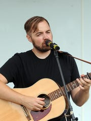 Jason Ropp performs on the Fountain Stage Saturday
