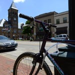A bicycle rests locked to a lamp post Monday on Main Street in Lancaster. Destination Downtown Lancaster is advocating for the installation of more bicycle racks downtown to discourage people from illegally locking bikes to lamp posts, flag poles and mailboxes.