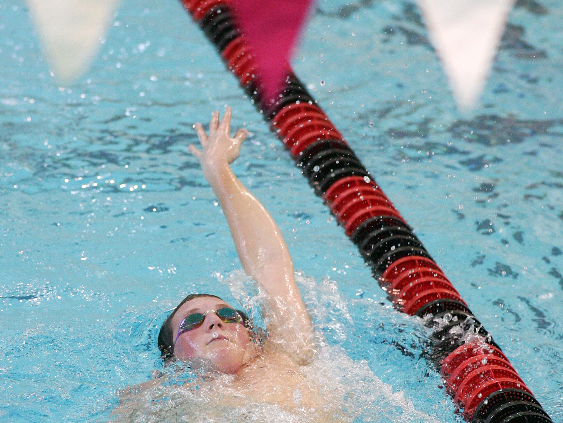 Watkins Memorial's Skylar Chapman practices with the swim team Tuesday at Denison.