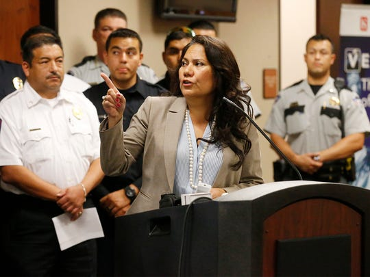 County Judge Veronica Escobar points to data on a chart