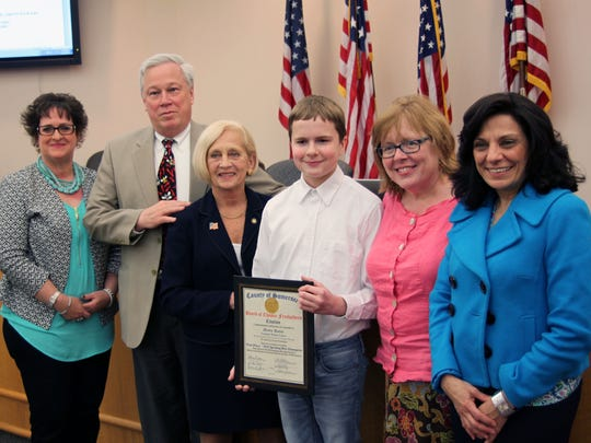 Catherine DeBerry, SCLSNJ librarian and Bee Spectacular co-coordinator; Brian Auger, SCLSNJ County Library Administrator; Patricia L. Walsh, Director of the Somerset County Board of Chosen Freeholders; Henry Banta, SCLSNJ Bee Spectacular winner; Pat Banta, Henry's mother; and Marcela Dunham, SCLSNJ staff member and Bee Spectacular co-coordinator.
