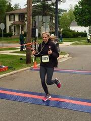 Abigail Longhurst, 27, of Battle Creek, wins the women's