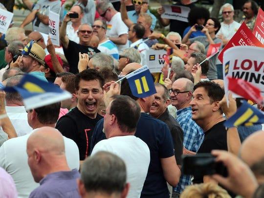 Actor John Barrowman is seen in the crowd celebrating