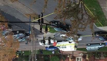 The scene Sunday, Oct. 11, 2015, at College Avenue and N. Goodman Street after a speeding car was stopped by the Rochester Police Department after it deployed spike strips to slow car down.