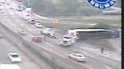 A tractor-trailer lies on its side on the ramp from southbound Interstate 95 to the northbound Hutchinson River Parkway in the Bronx on Aug. 6, 2014, in a Thruway Authority traffic camera image.