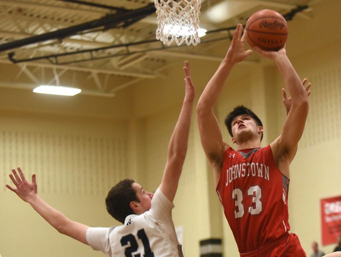 Wellington's John Faller tries to block a shot from