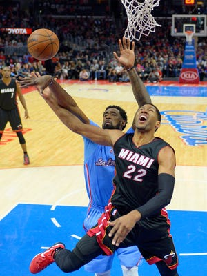 Miami Heat forward Danny Granger, right, puts up a shot against the Los Angeles Clippers on Jan. 11, 2015, in Los Angeles.