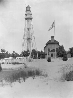 Twin River Point Lighthouse stands north of Two Rivers in 1913.