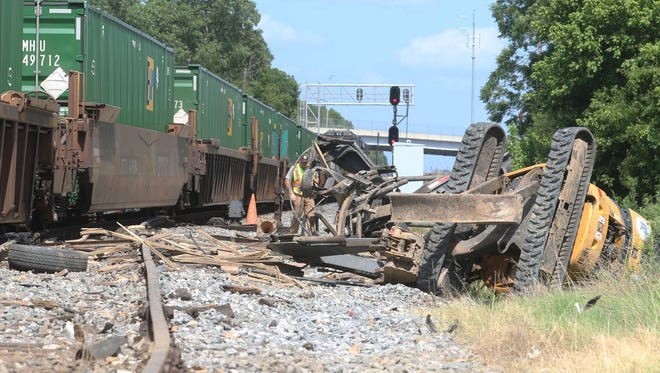 A train struck a water distribution truck pulling a 16-foot trailer carrying a mini excavator around 3 p.m. at Oak Street and South 11th Street in Monroe on Friday. The truck belonged to the Monroe Public Works department. No one was injured.
