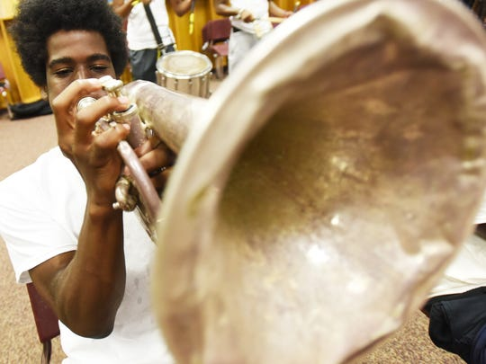 Marsalis Montgomery plays during band camp at  Booker