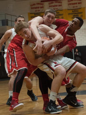 Haddonfield's Tyler Klaus (with ball) is pressured by Paulsboro's John Pellegrini (left) and Tyrique King.