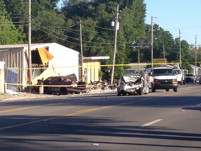 One person is dead after a four-door pickup crashed into a storage facility on Tippin Avenue.