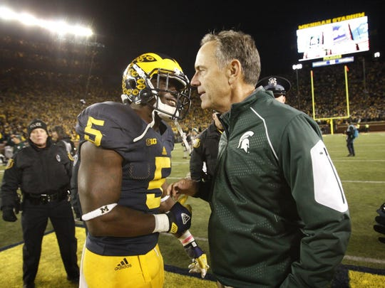 Michigan State coach Mark Dantonio shakes hands with Michigan safety Jabrill Peppers after the crazy finish in the Big House.