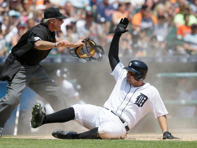 Detroit Tigers' Nick Castellanos is called safe by