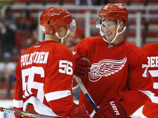 Red Wings left wing Teemu Pulkkinen and center Dylan Larkin, right, celebrate after the Red Wings defeated the Penguins, 6-1, in a preseason game in Detroit on Sept. 24.