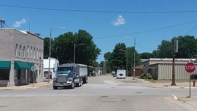 Lacon's N. Main Street, seen here looking north from Illinois Route 17, sometimes carries 300 loaded semis a day to a grain elevator, resulting in the need for frequent repairs of pavement unsuitable for that heavy use, officials say. The city hopes to receive a Rebuild Illinois grant for a $1.1 million upgrade.