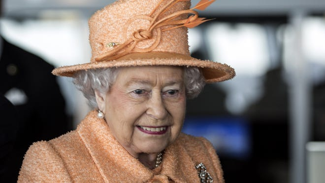 Queen Elizabeth II in one of her iconic outfits, in March 2015.